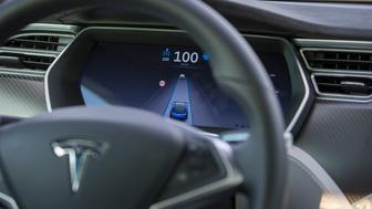 A dashboard monitor displays the lane-keeping feature during hands-free test drive in a Tesla Motors Inc. Model S electric automobile, equipped with Autopilot hardware and software, on a highway in Amsterdam, Netherlands, on Monday, Oct. 26, 2015. Tesla started equipping the Model S with hardware -- radar, a forward-looking camera, 12 long-range sensors, GPS -- to enable the autopilot features about a year ago. Photographer: Jasper Juinen/Bloomberg via Getty Images