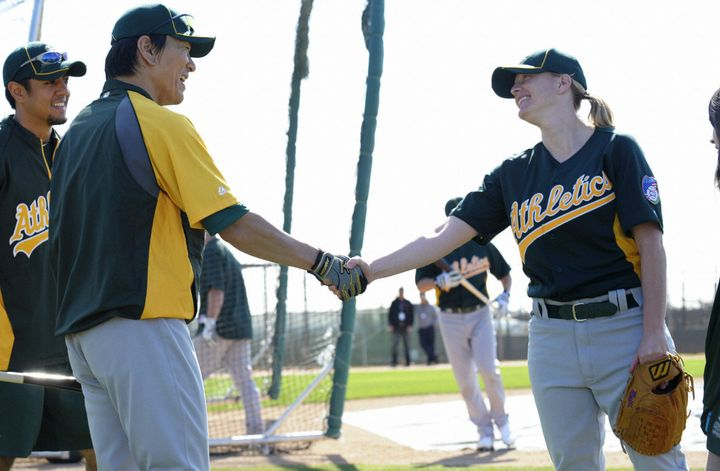 Justine Siegal shookhands with former Oakland A's player Hideki Matsui before she threw batting practice to the team in