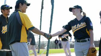 PHOENIX, United States - The Oakland Athletics' Hideki Matsui (L) shakes hands with Justine Siegal, who became the first woman to throw batting practice to major league hitters, at the club's spring training facility in Phoenix, Arizona, on Feb. 23, 2011. (Kyodo)