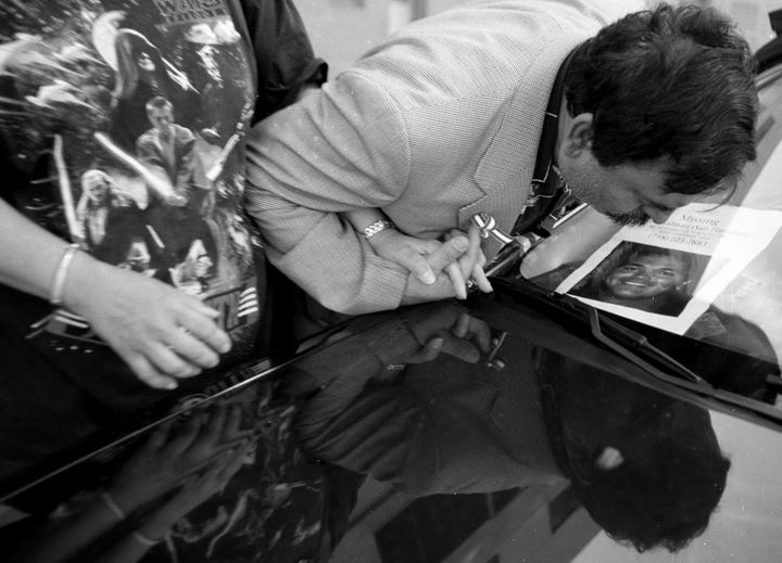 Mohammad and Talat Hamdani kiss a photo of their son on Sept. 17, 2001.