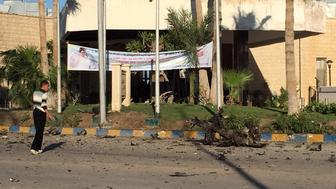 A man looks at the damage outside the Swiss Inn hotel in the Egyptian town of El-Arish, in the Sinai peninsula, following an attack on the hotel by two suicide bombers and a gunman on November 24, 2015. The attackers killed four people, including a judge, in the assault on the hotel hosting judges overseeing Egypt's parliamentary polls, the government said. AFP PHOTO / STR / AFP / -        (Photo credit should read -/AFP/Getty Images)