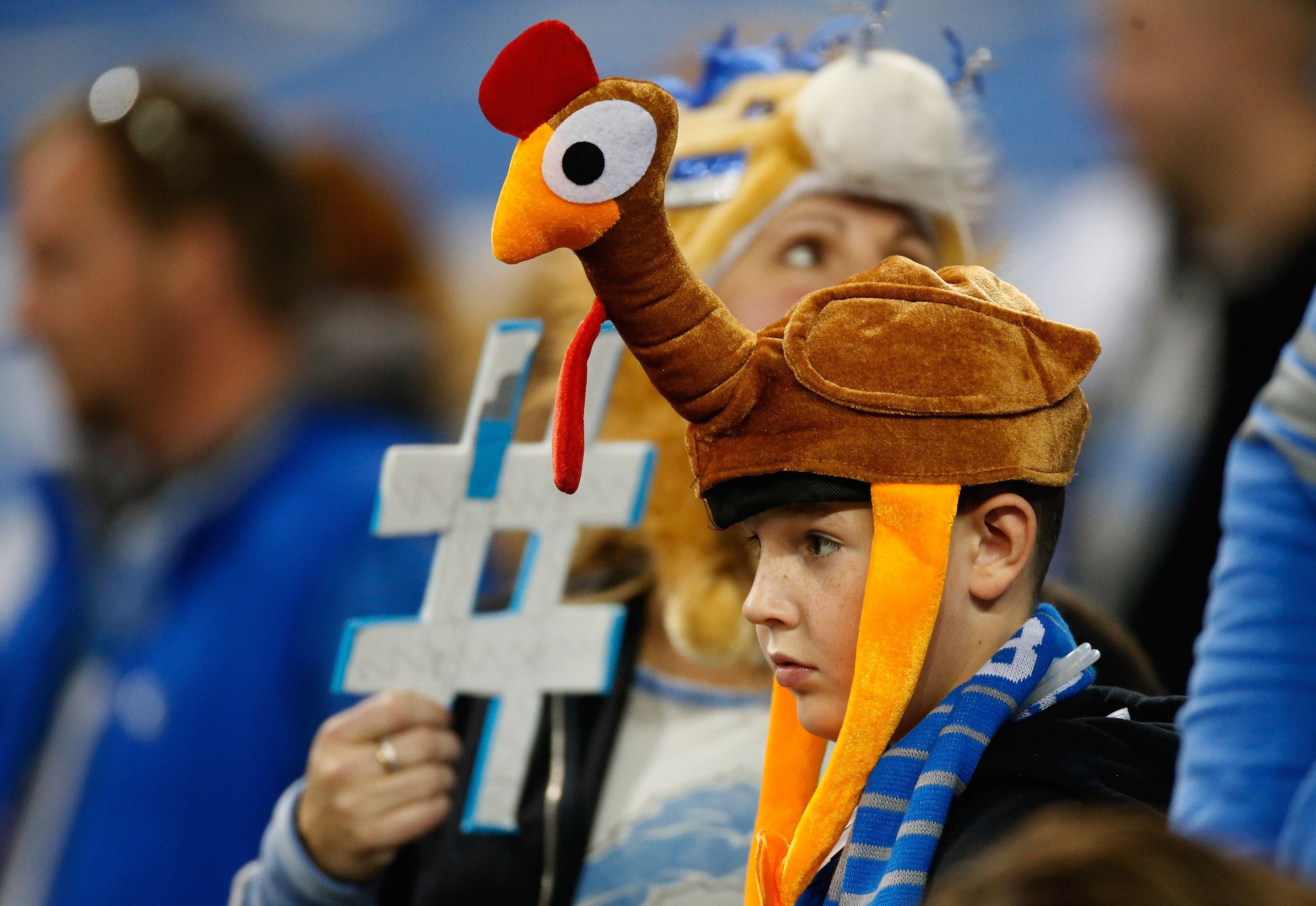 A young fan with a turkey hat looks on during the Thanksgiving day game between the Lions and theBears at Ford Field on