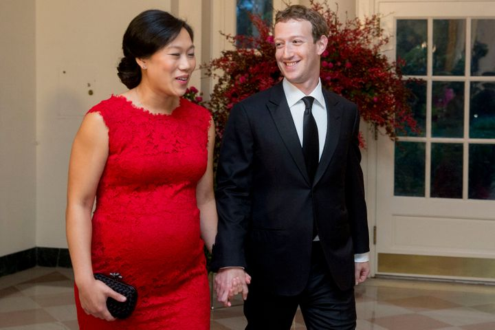 Mark Zuckerberg, chief executive officer and founder of Facebook Inc., right, and his wife Priscilla Chan arrive at a state d