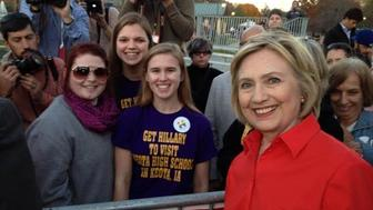 Abby Schulte, Megan Adam and Kylea Tinneas pose with Hillary Clinton following a campaign event in Coralville, Iowa on November 3, 2015.