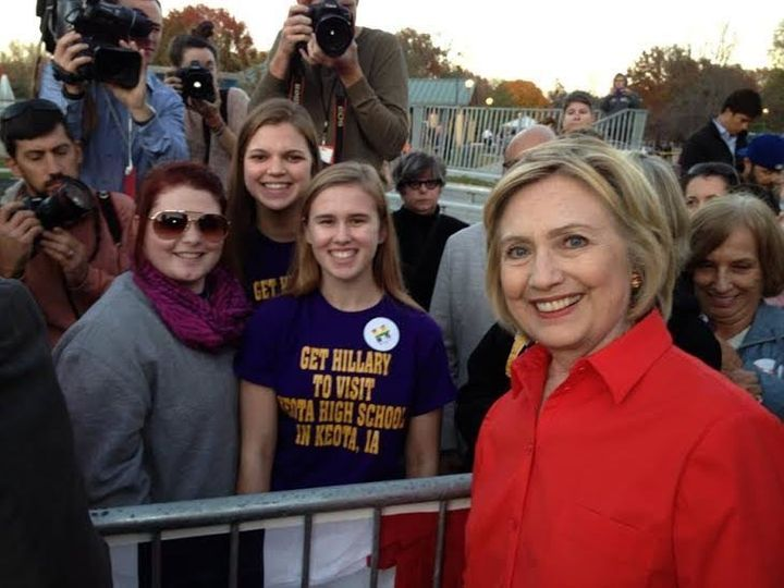 Abby Schulte, Megan Adam and Kylea Tinneas pose with Hillary Clinton following a campaign event in Coralville, Iowa, on Nov.&