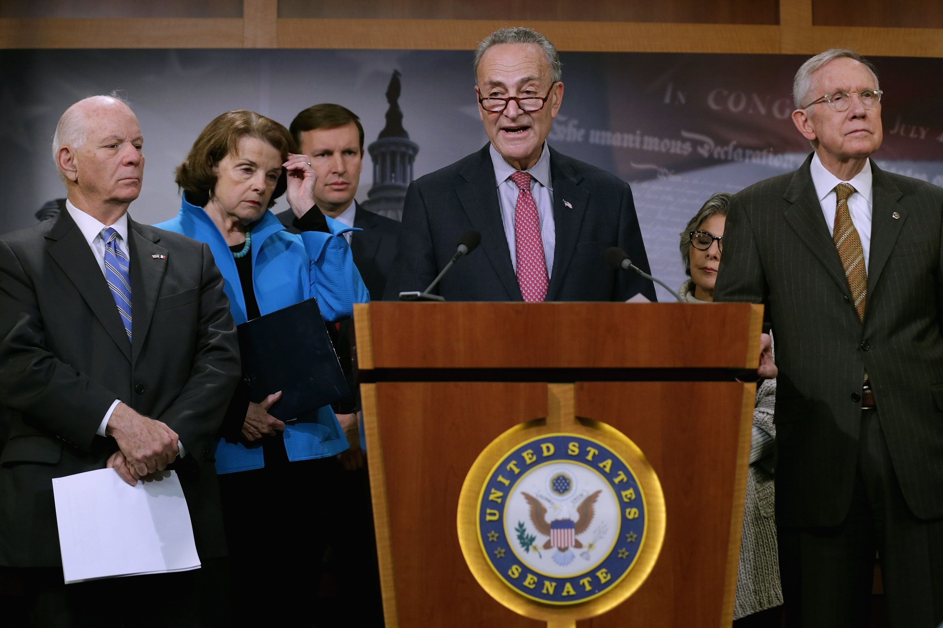 WASHINGTON, DC - NOVEMBER 19:  (L-R) Sen. Ben Cardin (D-MD), Sen. Dianne Feinstein (D-CA), Sen. Chris Murphy (D-CT), Sen. Charles Schumer (D-NY) and  Senate Minority Leader Harry Reid (D-NV) hold a news conference about Democratic legislative proposals in the wake of last week's terror attacks in Paris at the U.S. Capitol November 19, 2015 in Washington, DC. Senate Democrats proposed tightening the visa waiver program, requiring more biometric information and e-chip passports from overseas travelers visiting the United States and closing a loophole that allows people on the Terrorist Screening Center's No Fly List to purchase firearms or explosives. 'If you are too dangerous to board a plane then you are too dangerous to buy a gun,' said Feinstein.  (Photo by Chip Somodevilla/Getty Images)