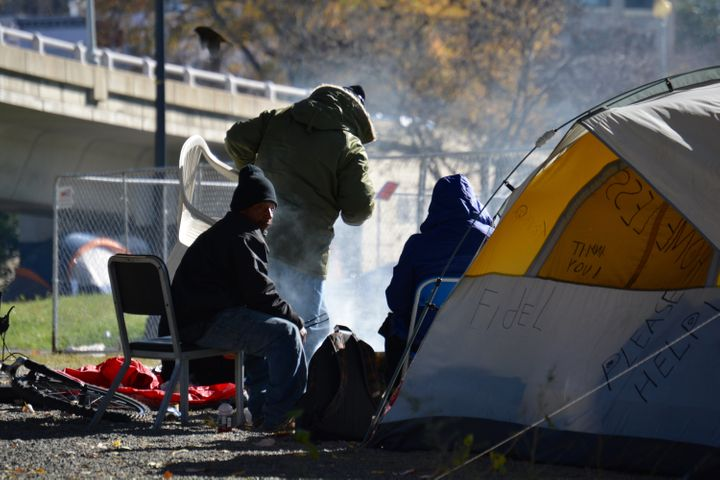 Homeless campers heating food near the Watergate Hotel in Washington, D.C.