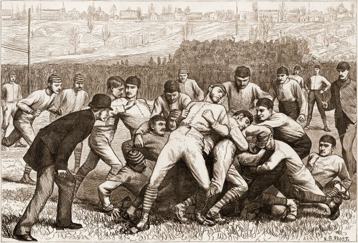 Wood engraving from Harper's Weekly magazine depicts on-field action during a football gamebetween Yale and Princeton o