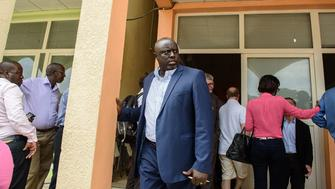 Antoine Kaburahe (C), director of the Iwacu media group, stands outside of the offices of Iwacu in Bujumbura on May 19, 2015. Four key private radio stations were attacked and closed during the coup bid against Burundian President Pierre Nkurunziza, and there is now virtually no independent media in the country. Innocent Muhozi, who heads Renaissance television and radio, tried on Tuesday to reopen the station, but was blocked by police. Muhozi called promises of press freedom by the presidency a 'joke.' AFP PHOTO / JENNIFER HUXTA        (Photo credit should read Jennifer Huxta/AFP/Getty Images)