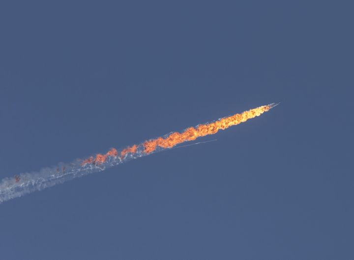 A Russian warplane goes down in Syria's northwestern Turkmen town of Bayirbucak near Turkeys border on November 24, 2015.