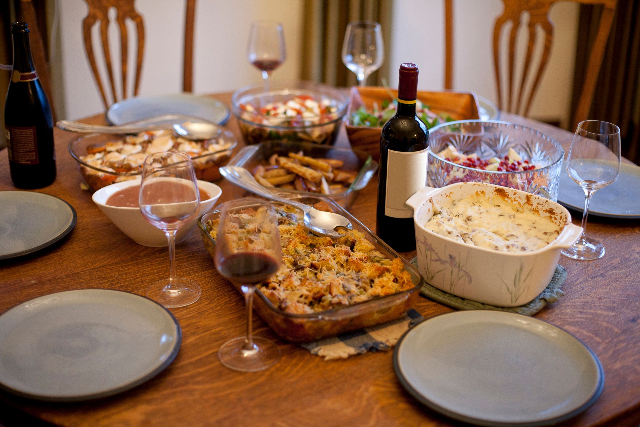 A tabletop is full of organic and locally made Thanksgiving dishes at a home in Portland, Oregon.