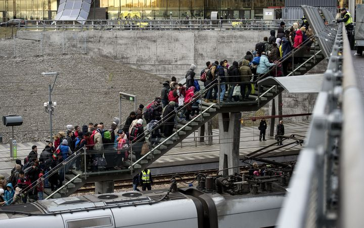Refugees arrive in Sweden from Denmark in November. The Swedish government now says it cannot offer incoming refugees permane