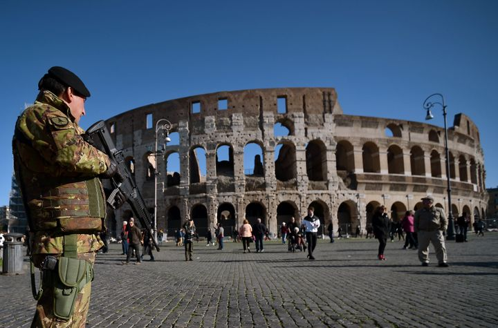 A soldier patrols near the Colosseum on Wednesday. Italian Prime Minister Matteo Renzi said in his security budget announceme