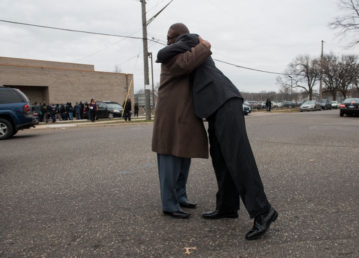 Two attendees embrace outside the funeral service of Jamar Clark at Shiloh Temple on November 25, 2015 in Minneapolis, Minnes