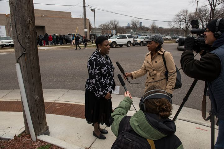 Arnetta Phillips, Director of Community Outreach Services at Shiloh Temple, speaks with media members outside the funeral ser
