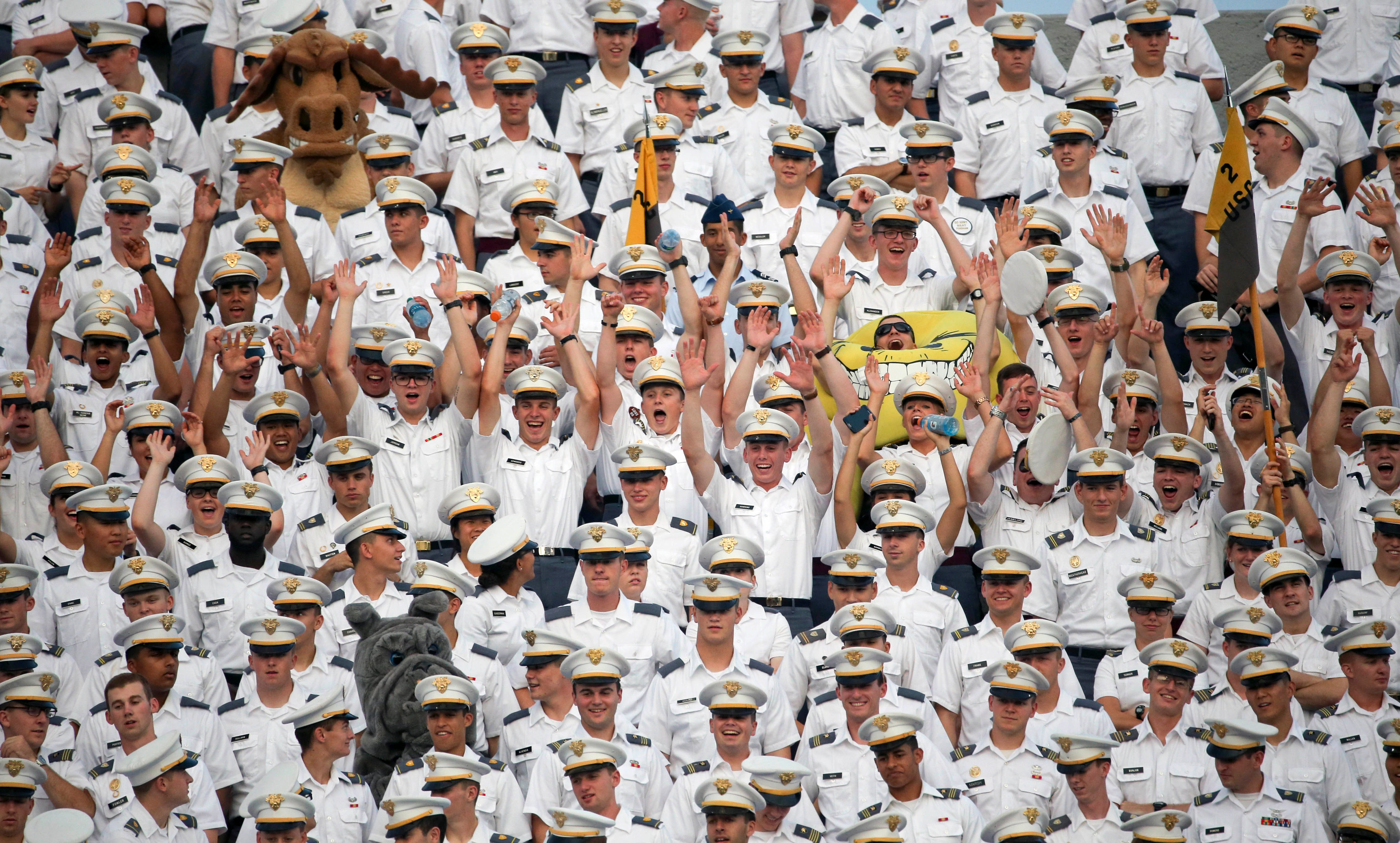 In this Friday, Sept. 4, 2015, photo, cadets cheer during the first half of an NCAA college football game between Army and Fordham in West Point, N.Y. More than a dozen students were injured during the annual pillow fight by first year cadets on Aug. 20, 2015, when some participants put hard objects inside their pillow cases, according to a story in the New York Times on Saturday, Sept. 5. (AP Photo/Mike Groll)