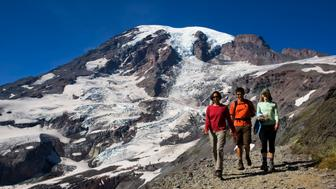 UNITED STATES - 2008/09/13: USA, Washington State, Mt. Rainier National Park, View Of Mt. Rainier From Skyline Trail, Hikers. (Photo by Wolfgang Kaehler/LightRocket via Getty Images)
