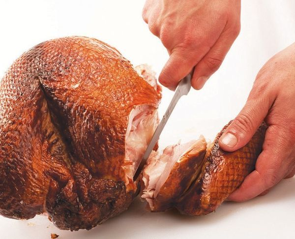 Rotate the turkey so that the other wing is facing your guide hand. Repeat previous steps to remove it.