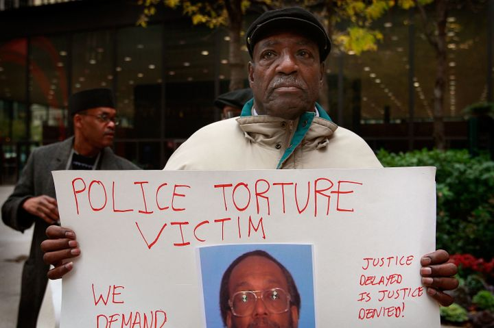 Aaron Cheney demonstrates outside the federal courthouse where former Chicago Police Commander Jon Burge was attending a hear