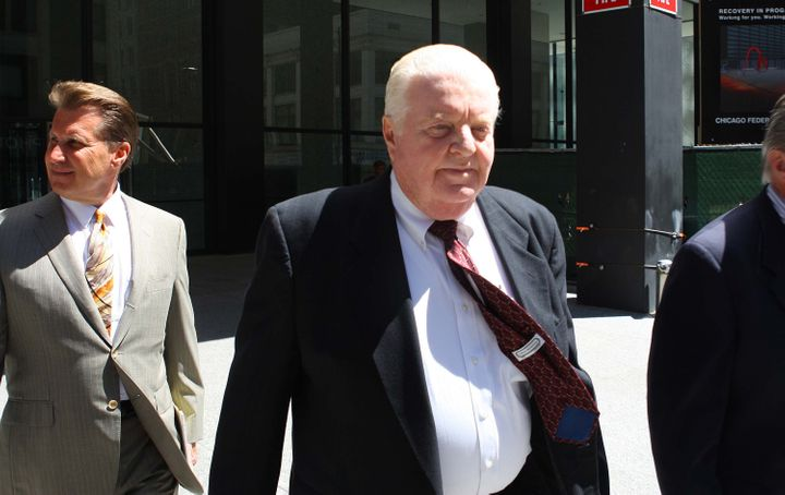 Former Chicago Police Cmdr. Jon Burge walks with members of his legal team into the Dirksen U.S. Courthouse, Monday, Jun. 28,