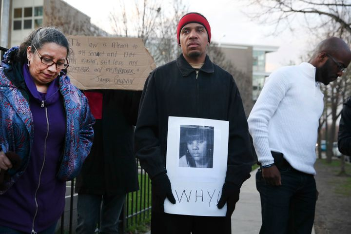 Donald Lightfoot holds a sign in support of Rekia Boyd while joining other protesters in Chicago on Monday, Apr. 20, 2015.