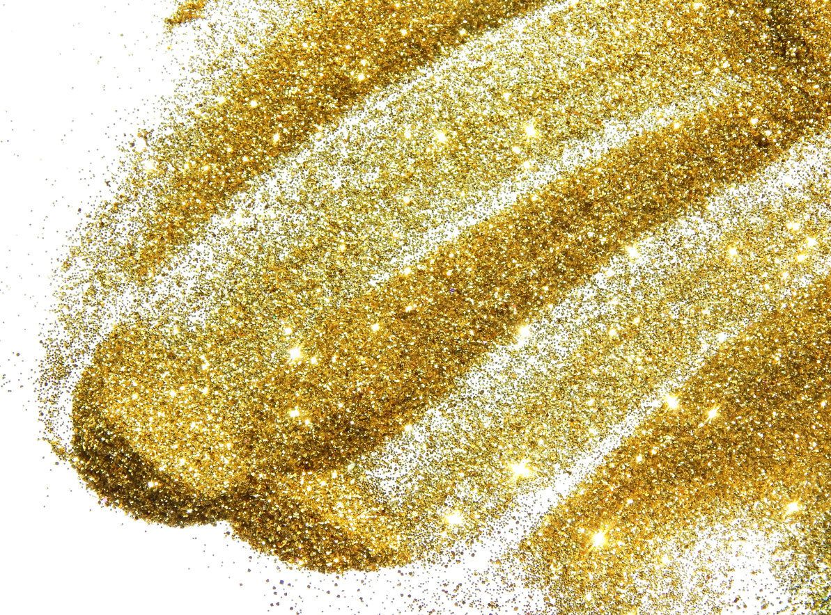 Golden glitter sparkle on white background
