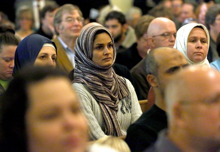 A woman looks on during a welcome event for refugees in an Allentown, PA church.