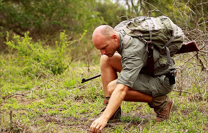 Bush walks offer viewers a unique experience from the ground, but guides can find themselves in dangerous situations. Some carry rifles in case of emergency.