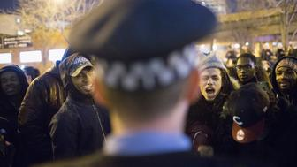 CHICAGO, IL - NOVEMBER 24:  Demonstrators confront police during a protest following the release of a video showing Chicago Police officer Jason Van Dyke shooting and killing Laquan McDonald on November 24, 2015 in Chicago, Illinois. Van Dyke was charged today with first degree murder for the October 20, 2014 shooting in which McDonald was hit with 16 bullets.  (Photo by Scott Olson/Getty Images)