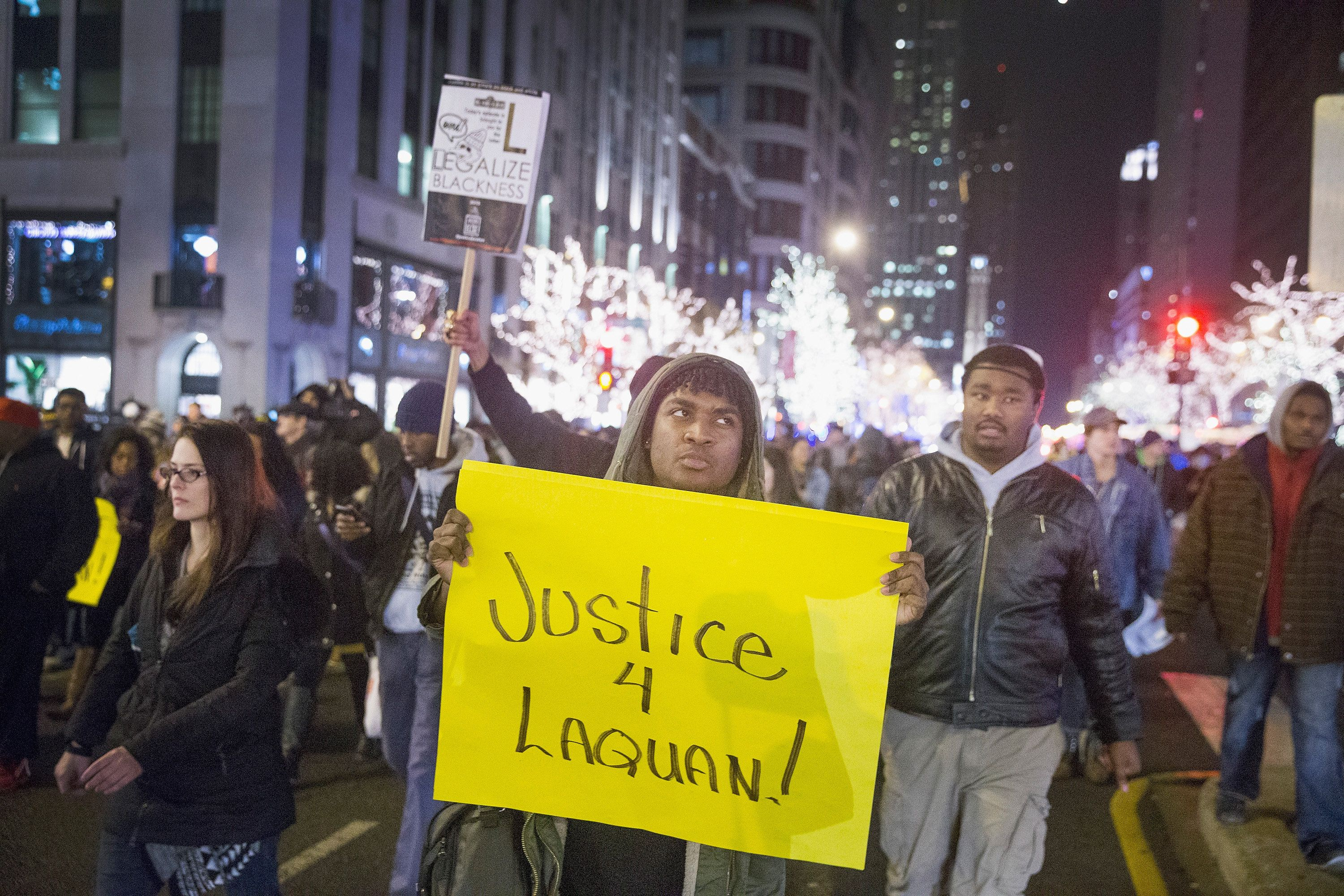 CHICAGO, IL - NOVEMBER 25:  Demonstrators protest in the middle of Michigan Avenue along the Magnificent Mile shopping district on November 25, 2015 in Chicago, Illinois. Small and mostly peaceful protests have sprouted up around the city following yesterday's release of a video showing Chicago Police officer Jason Van Dyke shooting and killing Laquan McDonald. Van Dyke has been charged with first degree murder for the October 20, 2014 shooting in which McDonald was hit with 16 bullets.  (Photo by Scott Olson/Getty Images)