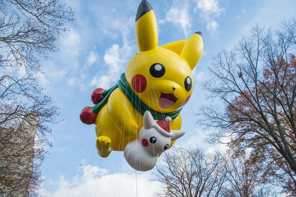 "<span class='image-component__caption' itemprop=""caption"">Pikachu makes its way through the parade with a little buddy in tow. </span>"
