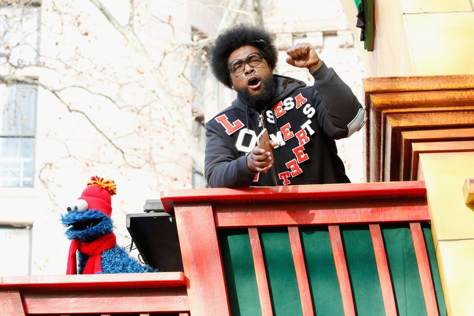 "<span class='image-component__caption' itemprop=""caption"">Drummer Questlove jams out on his float with Cookie Monster. </span>"