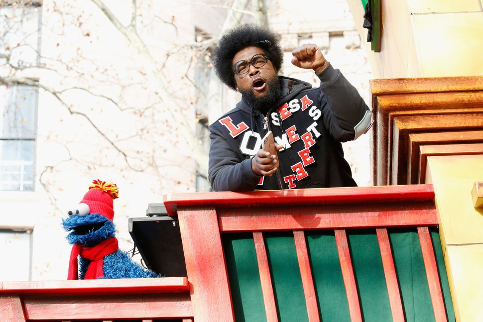 Drummer Questlove jams out on his float with Cookie Monster.