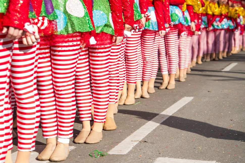 Candy cane-striped dancers line up for the parade.