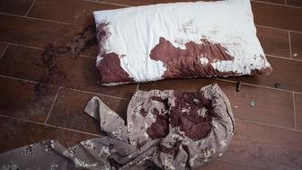 Bamako, Mali- A blood stained pillow and pants lie on the floor next to bullet casings in a guest room of the Radisson Blu Hotel three days after a deadly attack by Al Mourabitoun, an Al-Qaeda affiliate killing close to two dozen people in Bamako, Mali on Monday, November 23, 2015. (Jane Hahn for the Washington Post)