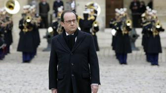 French President Francois Hollande arrives to lead the solemn ceremony on November 27, 2015 at the Hotel des Invalides, for the National Tribute to the 130 people killed in the November 13 Paris attacks. Families of those killed in France's worst-ever terror attack, claimed by the Islamic State (IS) group, will join some of the wounded at ceremonies at the Invalides   AFP PHOTO / POOL / PHILIPPE WOJAZER / AFP / POOL / PHILIPPE WOJAZER        (Photo credit should read PHILIPPE WOJAZER/AFP/Getty Images)