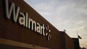 Wal-Mart Stores Inc. signage is displayed outside of a store in Louisville, Kentucky, U.S., on Friday, May 15, 2015. Wal-Mart Stores Inc. is expected to release first-quarter earnings results before the opening of U.S. financial markets on May 19. Photographer: Luke Sharrett/Bloomberg via Getty Images