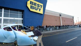 JERSEY CITY, NJ - NOVEMBER 27: A Best Buy Employee opens the door to Customers for Black Friday Sales on November 27, 2015 in Jersey City, New Jersey.  It was expected that 135.8 million Americans would shop this Black Friday weekend, according to the National Retail Federation .(Photo by Kena Betancur/Getty Images)