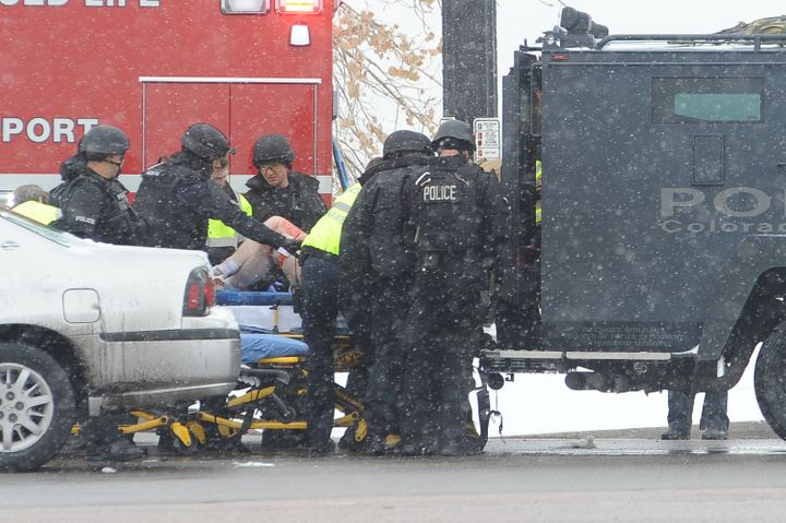 An unidentified victim is transported into an ambulanceafter a gunman opened fire at a Planned Parenthood facility in C