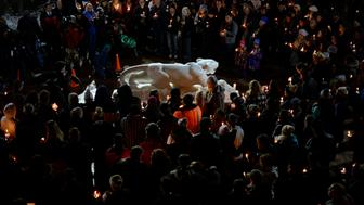 COLORADO SPRINGS,CO -  November 28: Hundreds gather around the University of Colorado at Colorado Springs Mountain Lion statue during a candlelight vigil at the Gallogy Events Center November 28, 2015 for UCCS police officer Garrett Swasey who was shot and killed along with two others at the Colorado Springs Planned Parenthood clinic November 27, 2015. Several others were injured including five law enforcement  officers. Photo by Andy Cross/The Denver Post via Getty Images