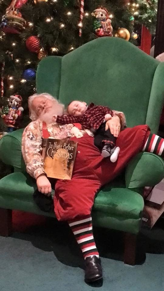 Baby Zeke is seen passed out with Santa Claus during a heartwarming photoshoot at an Indiana mall.