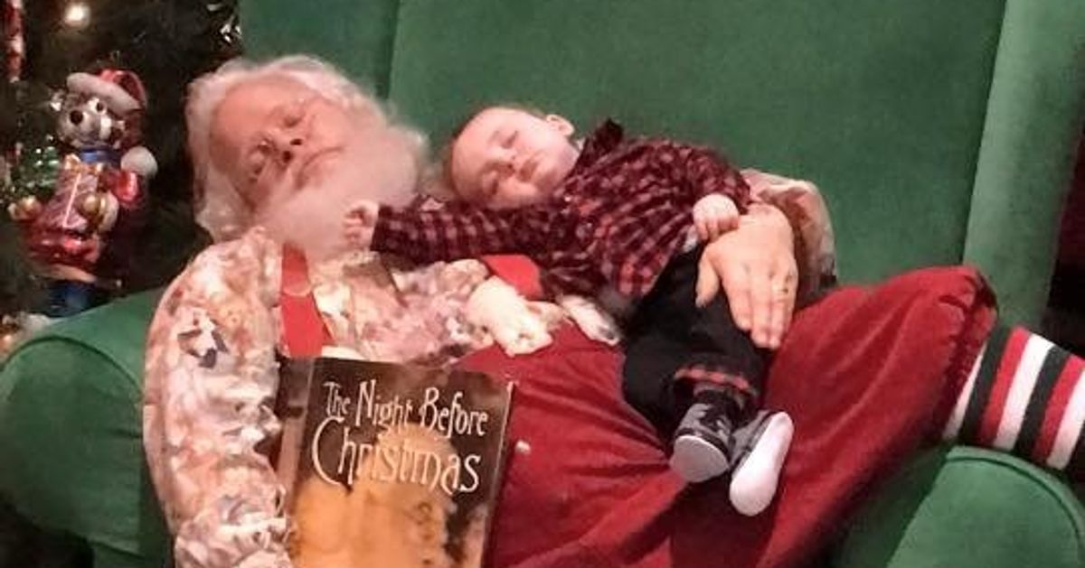 This 6-month-old didn't let sleep keep him from meeting Kris Kringle.