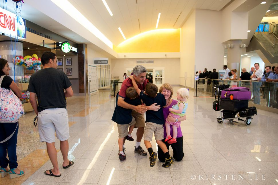 <i>This Georgia couple brought home their daughter from China. Her big brothers and grandparents excitedly greeted them at th