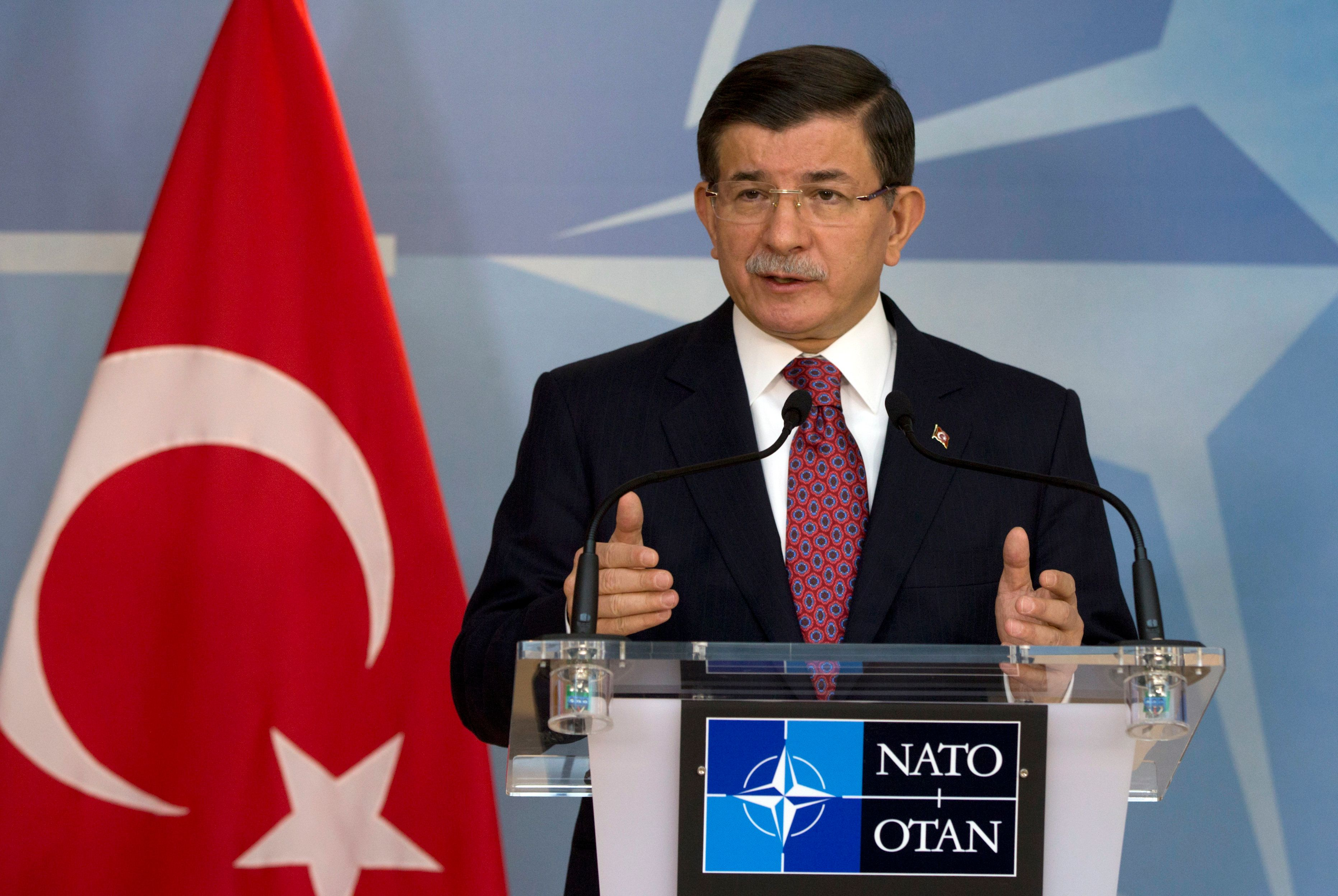 Turkish Prime Minister Ahmet Davutoglu speaks during a media conference at NATO headquarters in Brussels on Monday, Nov. 30, 2015. NATO Secretary General Jens Stoltenberg met with the Turkish prime minister on Monday to discuss the issue of a Russian warplane downed by a Turkish fighter jet at the border with Syria. (AP Photo/Virginia Mayo)
