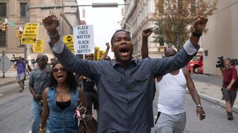 BALTIMORE, MD- SEPTEMBER 02: Several protesters march and rally in downtown Baltimore.  Some even blocked intersections impeding traffic. Today is the first hearing for six Baltimore police officers charged in the death  Freddie Gray in Baltimore, Maryland on September 02, 2015. (Photo by Marvin Joseph/The Washington Post via Getty Images)
