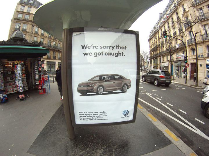 Art collective Brandalism put up street art in Paris protesting corporate sponsorship of the U.N. climate talks.