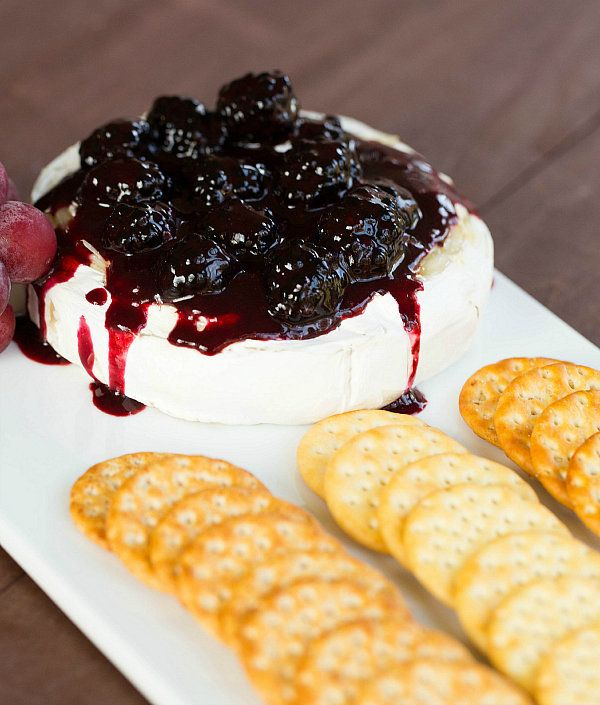 """<strong>Get the <a href=""""http://www.browneyedbaker.com/baked-brie-with-blackberry-compote/"""" target=""""_blank"""">Baked Brie With B"""