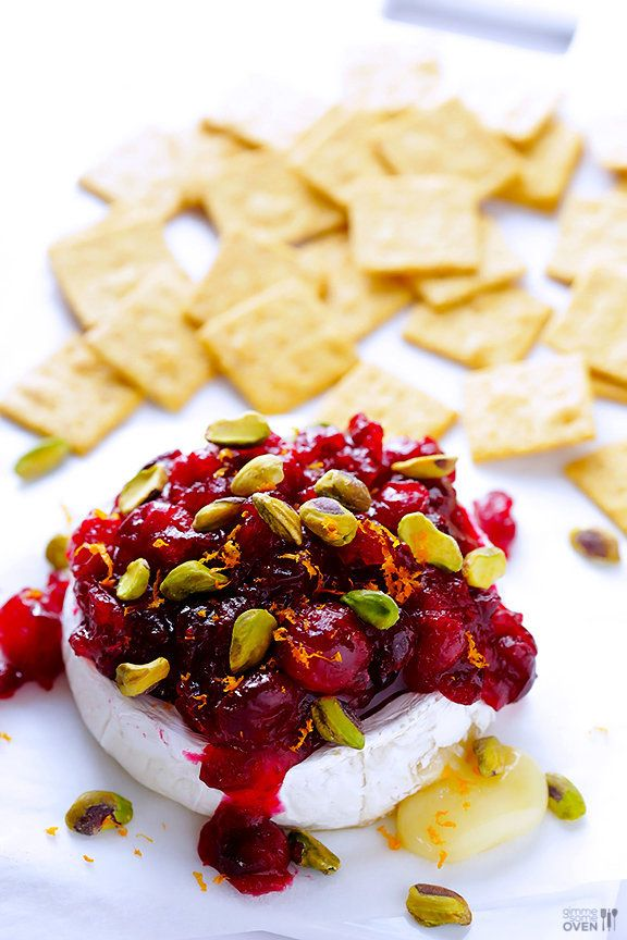 """<strong>Get the <a href=""""http://www.gimmesomeoven.com/cranberry-pistachio-baked-brie/"""" target=""""_blank"""">Cranberry Pistachio Ba"""