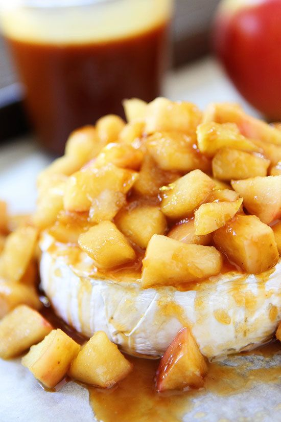 """<strong>Get the <a href=""""http://www.twopeasandtheirpod.com/baked-brie-with-apples-and-salted-caramel/"""" target=""""_blank"""">Baked"""