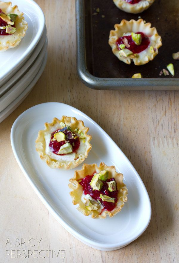 """<strong>Get the <a href=""""http://www.aspicyperspective.com/2013/11/baked-brie-bites.html"""" target=""""_blank"""">Baked Brie Bites rec"""